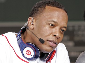 Recording artist Dr. Dre wears a pair of Beats headphones as he attends the MLB 2010 season opener between the New York Yankees and Boston Red Sox at Fenway Park in Boston, in this file photo taken April 4, 2010. Apple Inc is close to buying headphone maker Beats Electronics for $3.2 billion, the Financial Times reported.  The purchase of Beats, which also runs a streaming music service, would be the company's largest ever acquisition, the newspaper reported.   REUTERS/Adam Hunger/Files   (UNITED STATES - Tags: ENTERTAINMENT BUSINESS)