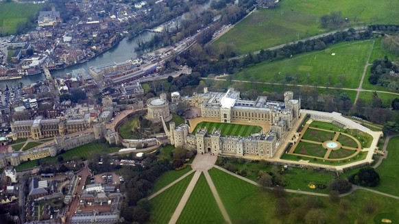 In this photo taken on Sunday, March 25, 2018, an aerial view of Windsor Castle in Berkshire, England,  which will host the wedding of Britain's Prince Harry and Meghan Markle in May. (Owen Humphreys/PA via AP)