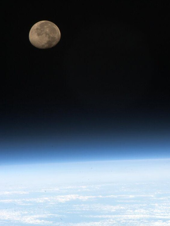 In this image provided by NASA shows moonset over earth as seen from the International Space Station, Tuesday May 7, 2013. Moonsets can be seen 16 times a day from the International Space Station. (AP Photo.NASA, Cmdr. Chris Hadfield)