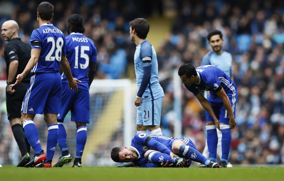 """Britain Football Soccer - Manchester City v Chelsea - Premier League - Etihad Stadium - 3/12/16 Chelsea's Eden Hazard lies injured Action Images via Reuters / Jason Cairnduff Livepic EDITORIAL USE ONLY. No use with unauthorized audio, video, data, fixture lists, club/league logos or """"live"""" services. Online in-match use limited to 45 images, no video emulation. No use in betting, games or single club/league/player publications. Please contact your account representative for further details."""
