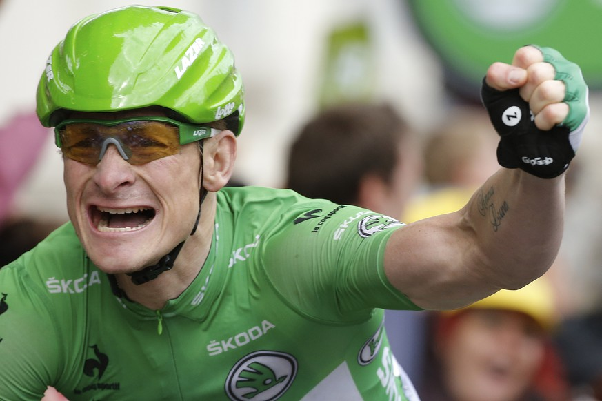 Germany's Andre Greipel celebrates as he crosses the finish line to win the fifth stage of the Tour de France cycling race over 189.5 kilometers (117.8 miles) with start in Arras and finish in Amiens, France, Wednesday, July 8, 2015. (AP Photo/Laurent Cipriani)