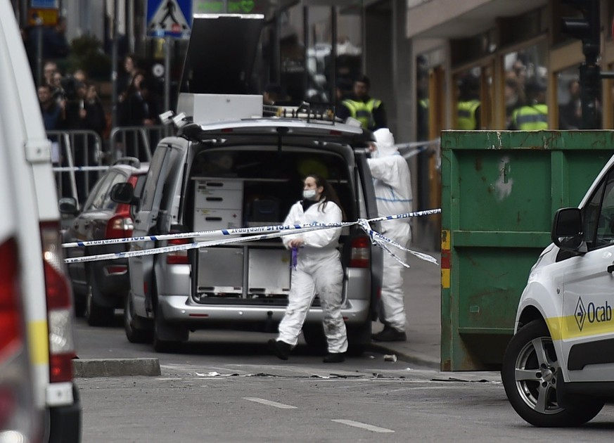 epa05896916 Swedish forensic police investigators work at the crime scene in central Stockholm, Sweden, 08 April 2017. A truck was driven into a department store on Drottninggatan street (Queen Street) in central Stockholm, on 07 April 2017,  media reported quoting local police killing four people, injuring 15 others.  EPA/NOELLA JOHANSSON SWEDEN OUT