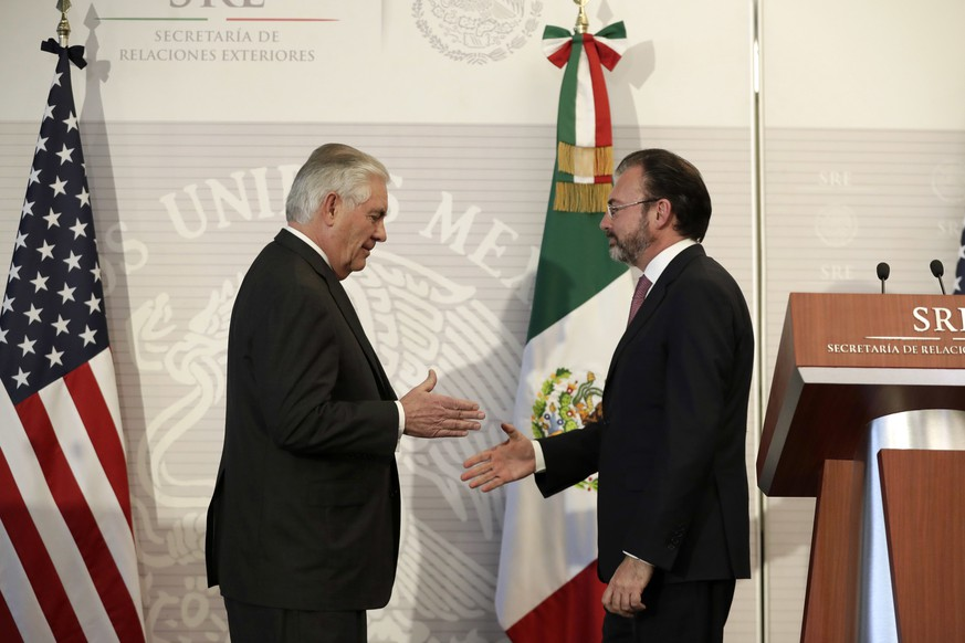 U.S. Secretary of State Rex Tillerson, left, shakes hands with Mexico's Foreign Relations Secretary Luis Videgaray after a joint statement to the press at the Foreign Affairs Ministry in Mexico City, Thursday, Feb. 23, 2017. Mexico's mounting unease and resentment over President Donald Trump's immigration crackdown are looming over a Thursday meeting between Tillerson, Homeland Security Secretary John Kelly, and Mexican leaders that the U.S. had hoped would project a strong future for relations between neighbors. (AP Photo/Rebecca Blackwell)