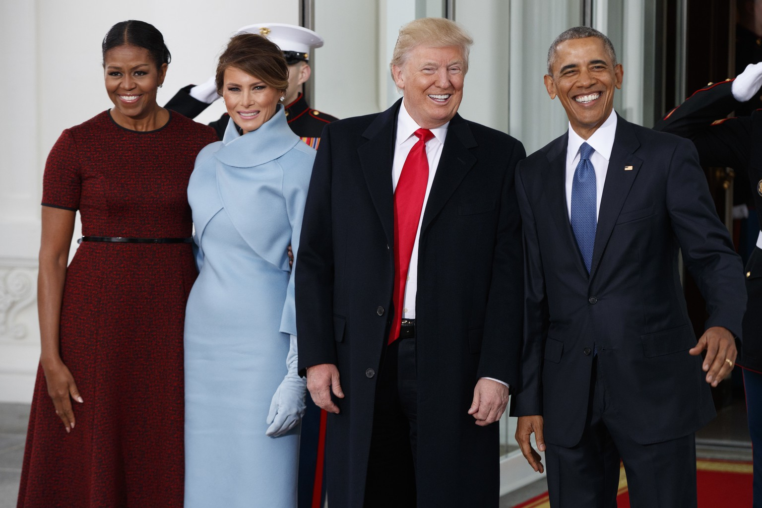 President Barack Obama, first lady Michelle Obama, President-elect Donald Trump and Melania Trump stand at the White House in Washington, Friday, Jan. 20, 2017. (AP Photo/Evan Vucci)