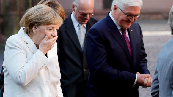 epa06241363 Chancellor Angela Merkel (L) and German President Frank-Walter Steinmeier (R) attend the celebrations of the Day of German Unity in Mainz, Germany, 03 October 2017. The German Day of Unity, celebrating the reunification of East and West Germany in 1990, with its official national ceremony and celebrations is taking place in Mainz on 03 October 2017.  EPA/RONALD WITTEK