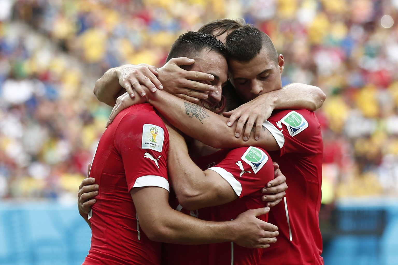 From left: Switzerland's Josip Drmic, Xherdan Shaqiri, Stephan Lichtsteiner and Granit Xhaka celebrate after Xherdan Shaqiri scored the 2-0 during the group E preliminary round match between Switzerland and Honduras in the Arena da Amazonia in Manaus, Brazil, Wednesday, June 25, 2014. (KEYSTONE/Peter Klaunzer)