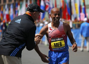 Meb Keflezighi (R) of the U.S. is congratulated by Greg Meyer, the last American male to  win the Boston Marathon, after winning the men's division at the 118th running of the Boston Marathon in Boston, Massachusetts April 21, 2014.      REUTERS/Brian Snyder (UNITED STATES  - Tags: SPORT ATHLETICS)