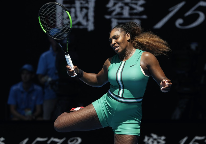 United States' Serena Williams reacts after hitting a ball to Karolina Pliskova of the Czech Republic during their quarterfinal match at the Australian Open tennis championships in Melbourne, Australia, Wednesday, Jan. 23, 2019. (AP Photo/Kin Cheung)