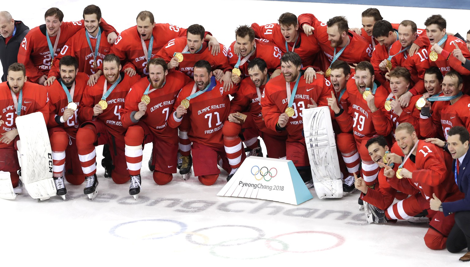 epa06563559 Gold medalists Olympic Athletes of Russia (OAR) react during the medal ceremony of the Men's Ice Hockey gold medal match between Olympic Athletes of Russia (OAR) and Germany at the Gangneung Hockey Centre during the PyeongChang 2018 Winter Olympic Games, in Gangneung, South Korea, 25 February 2018.  EPA/VALDRIN XHEMAJ