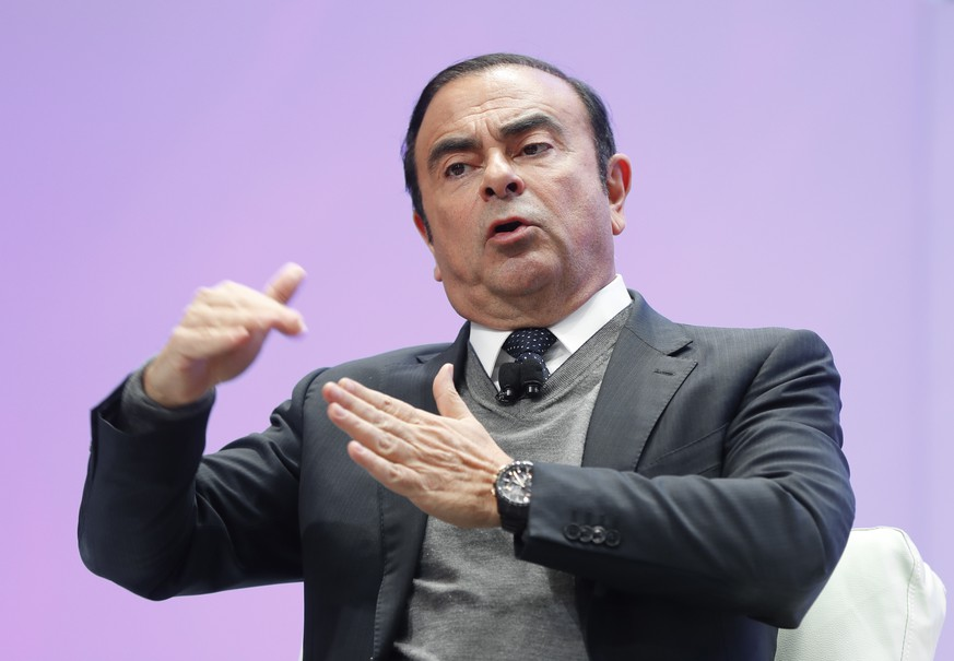 FILE - In this Jan. 9, 2017, file photo, Carlos Ghosn, Chairman of the Board and Chief Executive Officer of Nissan Motor Co., Ltd., speaks at the North American International Auto Show in Detroit. Nissan said Monday, Nov. 19, 2018, an internal investigation found Chairman Carlos Ghosn under-reported his income and he will be dismissed. (AP Photo/Paul Sancya, File)