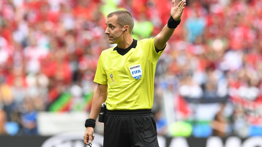 epa06824357 US referee Mark Geiger reacts during the FIFA World Cup 2018 group B preliminary round soccer match between Portugal and Morocco in Moscow, Russia, 20 June 2018.