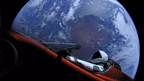 epa06506017 A handout photo made available by SpaceX on 08 Ferbuary 2018 shows a Tesla Roadster car in space after being launched with the SpaceX Falcon Heavy rocket, 06 February 2018. SpaceX, founded by Elon Musk, launched its Falcon Heavy rocket, the most powerful rocket in the world. As part of its payload the Falcon Heavy is carrying Musk's cherry red Roadster from Tesla, his electric car company.  EPA/SPACEX /  HANDOUT  HANDOUT EDITORIAL USE ONLY/NO SALES
