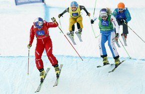 Switzerland's Fanny Smith, left, competes to place third at the women's freestyle ski cross event at the Freestyle Ski and Snowboard World Championships in Kreischberg, Austria, Sunday, Jan. 25, 2015. (AP Photo/Darko Bandic)