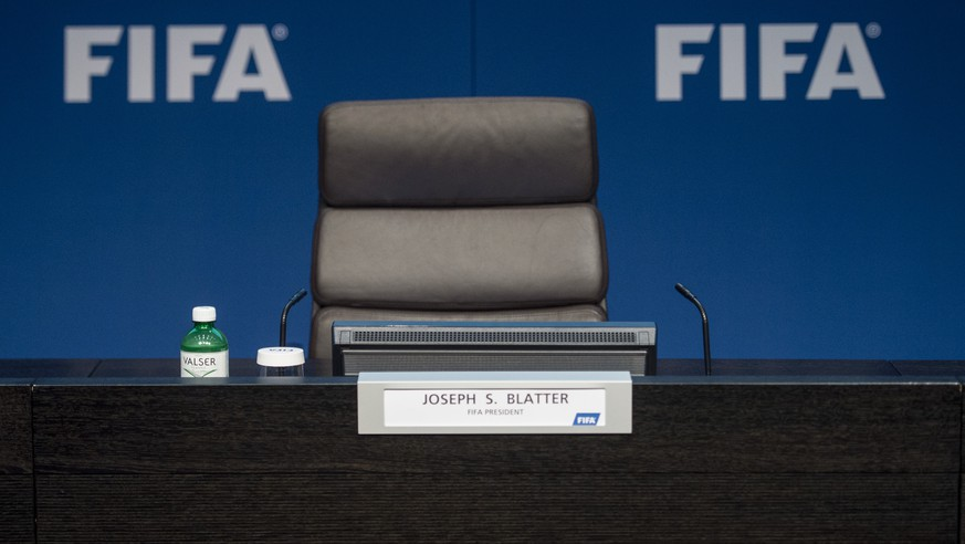 FILE - In this June 2, 2015 file photo the empty chair of FIFA President Sepp Blatter is pictured prior to a press conference at the FIFA headquarters in Zurich, Switzerland. The Sepp Blatter era at FIFA is set to finally end Friday, June 26, 2016 when soccer's scandal-scarred world body picks a new president after nine months of crisis. (Ennio Leanza/Keystone via AP, file)