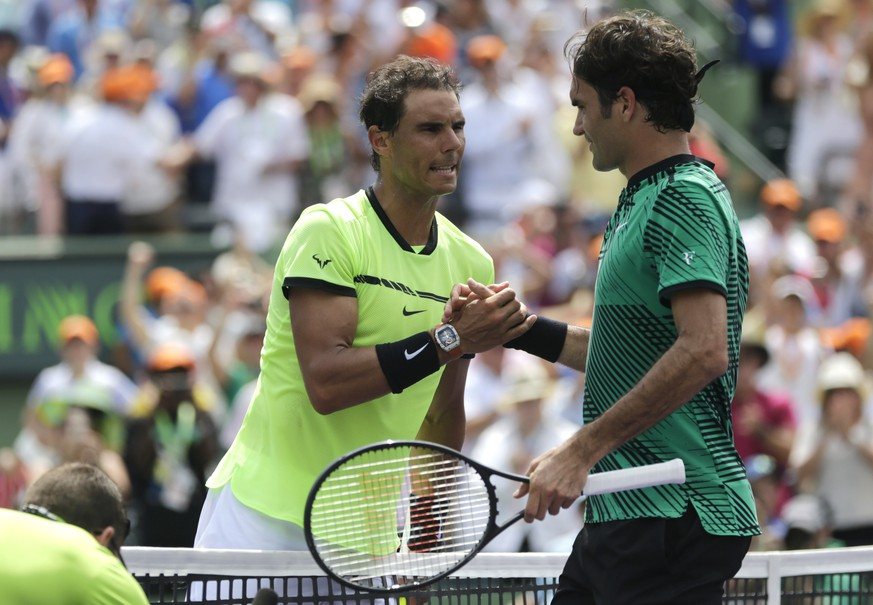 Rafael Nadal, left, of Spain, shakes hands with Roger Federer, of Switzerland, after the men's singles final at the Miami Open tennis tournament, Sunday, April 2, 2017, in Key Biscayne, Fla. (AP Photo/Lynne Sladky)