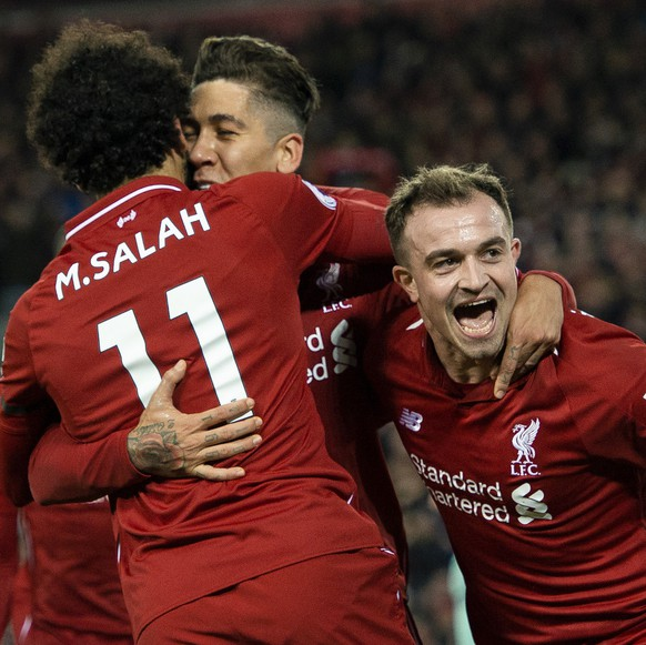 epaselect epa07253405 Liverpool's Roberto Firmino is congratulated by  Mohamed Salah and Xherdan Shaqiri (R) after scoring the sixth goal in the English Premier League soccer match between Liverpool and Arsenal at the Anfield in Liverpool, Britain, 29 December 2018.  EPA/PETER POWELL EDITORIAL USE ONLY. No use with unauthorized audio, video, data, fixture lists, club/league logos or 'live' services. Online in-match use limited to 120 images, no video emulation. No use in betting, games or single club/league/player publications