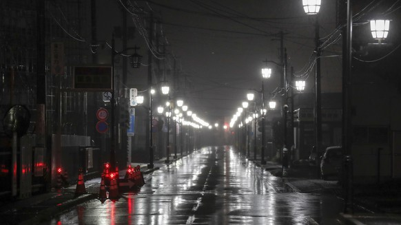 epa06590649 Lamps illuminate a street in Namie town, where tsunami-crippled Tokyo Electric Company (TEPCO)'s Fukushima Daiichi Nuclear Power Plant is located, Fukushima Prefecture, around 17:30 local time, Japan, 08 March 2018 (issued 09 March 2018), three days before the seventh anniversary of the 9.0-magnitude earthquake and subsequent tsunami that devastated the area. The tsunami following the magnitude 9.0 earthquake devastated Unit 1 to 4 at the TEPCO's nuclear power plant in 11 March 2011. The seventh anniversary of the 9.0-magnitude earthquake and subsequent tsunami that devastated northeastern Japan and triggered a nuclear disaster at the Fukushima Daiichi Nuclear Power Plant will be marked on 11 March 2018.  EPA/KIMIMASA MAYAMA