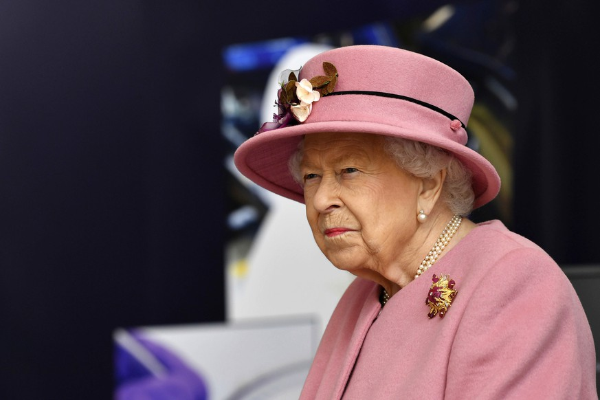 Britain's Queen Elizabeth II visits the Defence Science and Technology Laboratory (DSTL) at Porton Down, England, Thursday Oct. 15, 2020, to view the Energetics Enclosure and display of weaponry and tactics used in counter intelligence. (Ben Stansall/Pool via AP)