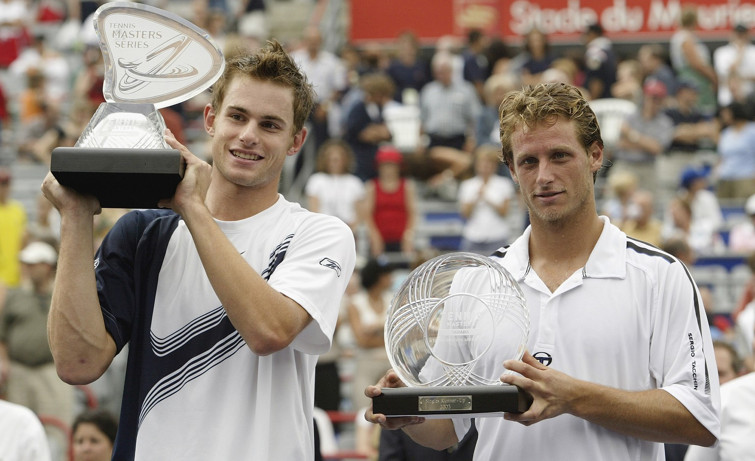 MONTREAL - AUGUST 10:  Andy Roddick of the USA (left) and David Nalbandian pose with their trophy's after the championship match of the Tennis Masters Canada on August 10, 2003 at Maurier Stadium in Montreal, Quebec.  Roddick defeated Nalbandian 6-1, 6-3.  (Photo by Elsa/Getty Images)