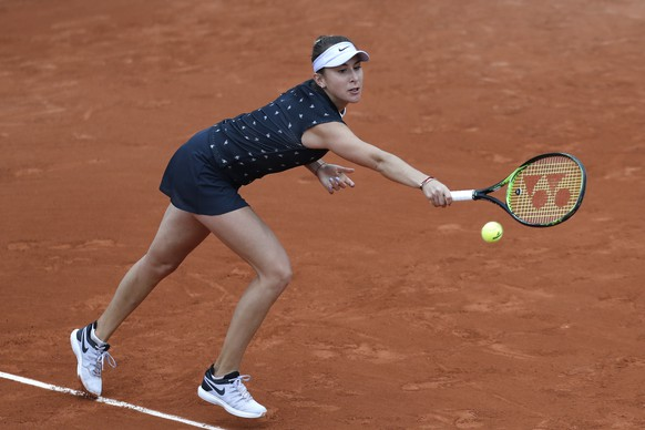 Belinda Bencic of Switzerland plays a shot against France's Jessika Ponchet in her first round match of the French Open tennis tournament against France's Jessika Ponchet at the Roland Garros stadium in Paris, Sunday, May 26, 2019. (AP Photo/Pavel Golovkin)