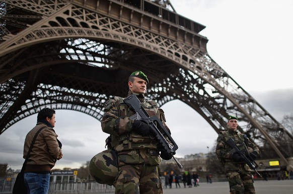 PARIS, FRANCE - JANUARY 12:  French troops patrol around the Eifel Tower on January 12, 2015 in Paris, France. France is set to deploy 10,000 troops to boost security following last week's deadly attacks while also mobilizing thousands of police to patrol Jewish schools and synagogues.  (Photo by Jeff J Mitchell/Getty Images) *** BESTPIX ***