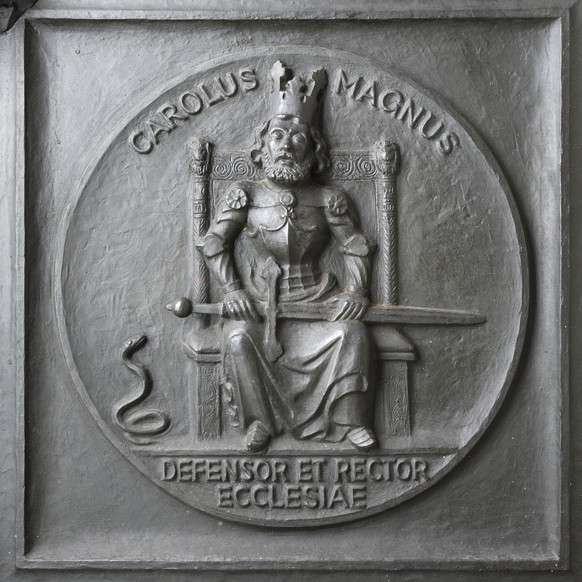6th row, 4th relief: Seal of the deanery of Grossmuenster, with the inscription