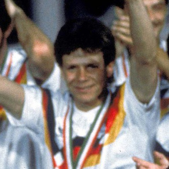 German soccer team players celebrate after winning the Soccer World Cup final in the Olympic Stadium, in Rome, Italy, on July 8, 1990. Germany defeated Argentina 1-0 to win the cup. Player kissing the cup is German captain Lothar Matthaus. German soccer coach Franz Beckenbauer, in dark jacket, is seen behind Matthaus (AP Photo/Carlo Fumagalli)