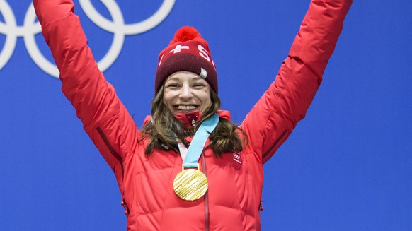 Gold medal winner Sarah Hoefflin of Switzerland celebrates during the victory ceremony on the Medal Plaza for the women Freestyle Skiing Slopestyle final at the XXIII Winter Olympics 2018 in Pyeongchang, South Korea, on Saturday, February 17, 2018. (KEYSTONE/Jean-Christophe Bott)