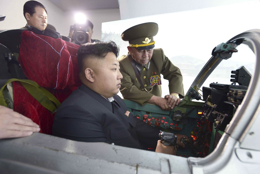 North Korean leader Kim Jong Un inspects the Korean People's Army (KPA) Air and Anti-Air Force Unit 447, which has been honoured with the title of O Jung Hup-led 7th Regiment, in this undated photo released by North Korea's Korean Central News Agency (KCNA) in Pyongyang on May 14, 2014. REUTERS/KCNA (NORTH KOREA - Tags: POLITICS MILITARY TRANSPORT TPX IMAGES OF THE DAY) ATTENTION EDITORS – THIS PICTURE WAS PROVIDED BY A THIRD PARTY. REUTERS IS UNABLE TO INDEPENDENTLY VERIFY THE AUTHENTICITY, CONTENT, LOCATION OR DATE OF THIS IMAGE. FOR EDITORIAL USE ONLY. NOT FOR SALE FOR MARKETING OR ADVERTISING CAMPAIGNS. NO THIRD PARTY SALES. NOT FOR USE BY REUTERS THIRD PARTY DISTRIBUTORS. SOUTH KOREA OUT. NO COMMERCIAL OR EDITORIAL SALES IN SOUTH KOREA. THIS PICTURE IS DISTRIBUTED EXACTLY AS RECEIVED BY REUTERS, AS A SERVICE TO CLIENTS