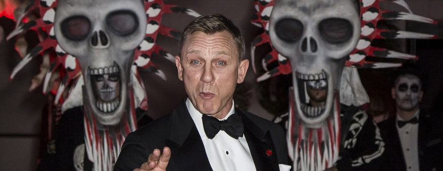 Daniel Craig poses for photographers upon arrival at the James Bond Spectre party in London, Monday, Oct. 26, 2015. (Photo by Vianney Le Caer/Invision/AP)