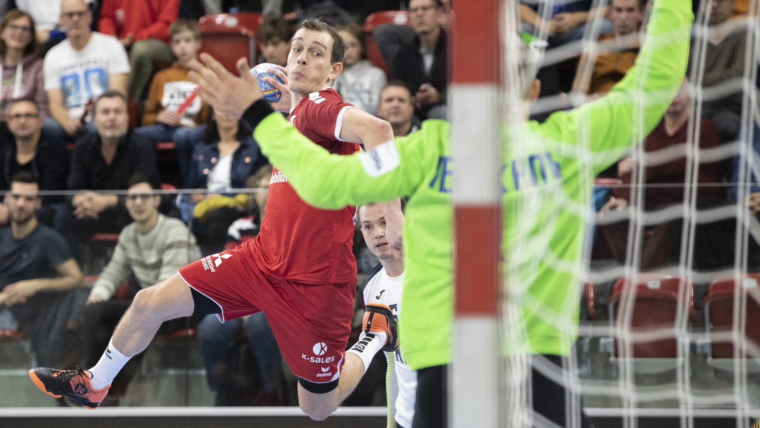 Switzerland's Marvin Lier, left, in action against Anton Terekhov, right, during the Yellow Cup Handball game between Switzerland and Ukraine in Switzerland, Winterthur, Friday 03 January 2020. (KEYSTONE/Ennio Leanza)