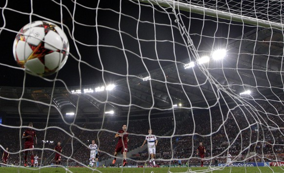 A ball hits the net as Bayern scores against Roma during the Group E Champions League soccer match between Roma and Bayern Munich at the Olympic stadium, in Rome, Tuesday, Oct. 21, 2014. (AP Photo/Andrew Medichini)
