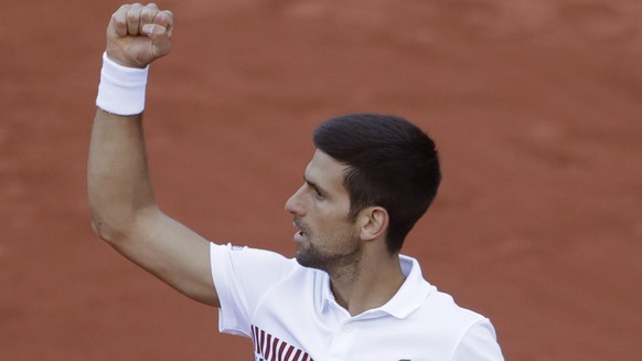 Serbia's Novak Djokovic clenches his fist after scoring a point against Spain's Albert Ramos-Vinolas during their fourth round match of the French Open tennis tournament at the Roland Garros stadium, in Paris, France. Sunday, June 4, 2017. (AP Photo/Petr David Josek)