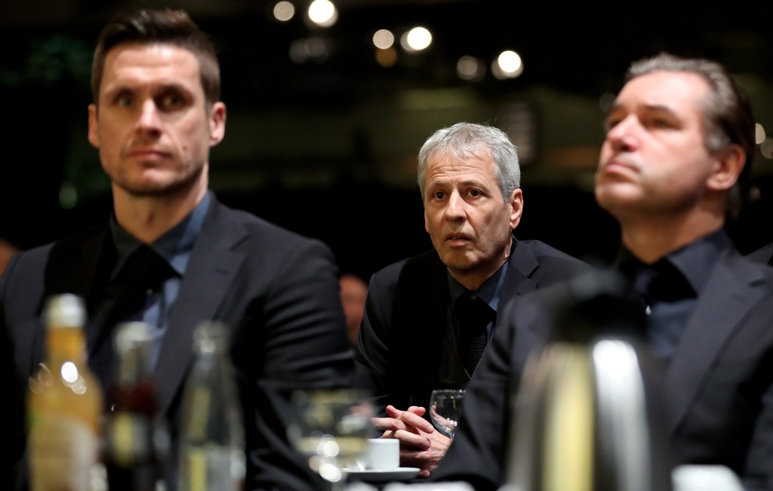 epa08021763 (L-R) Dortmund's head of the licensing player department, Sebastian Kehl, Dortmund's head coach Lucien Favre and Dortmund's sports director Michael Zorc attend the Annual General Meeting of Borussia Dortmund at the Westfalenhalle Dortmund in Dortmund, Germany, 24 November 2019.  EPA/FRIEDEMANN VOGEL