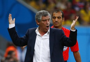 Greece's coach Fernando Santos gestures in front of fourth official Nawaf Shukralla of Bahrain during their 2014 World Cup round of 16 game against Costa Rica at the Pernambuco arena in Recife June 29, 2014. REUTERS/Tony Gentile (BRAZIL  - Tags: SOCCER SPORT WORLD CUP)         TOPCUP