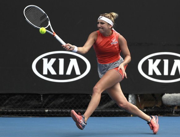 Switzerland's Timea Bacsinszky makes a forehand return to Russia's Natalia Vikhlyantseva during their second round match at the Australian Open tennis championships in Melbourne, Australia, Thursday, Jan. 17, 2019. (AP Photo/Mark Schiefelbein)