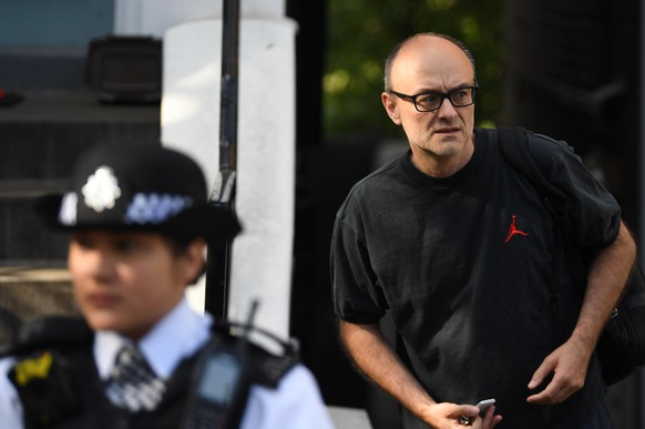 epa08449011 Dominic Cummings (R), Special Advisor to Britain's Prime Minister Boris Johnson, departs his home in London, Britain, 28 May 2020. Calls for Cummings's resignation have increased since news broke the Cummings violated lockdown regulations when he and his wife - both suspected of showing Covid-19 symptoms - travelled across the country to self-isolate at a family's property.  EPA/NEIL HALL