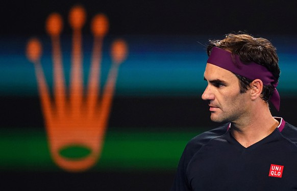 epa08158703 Roger Federer of Switzerland during his third round match against John Millman of Australia on day five of the Australian Open tennis tournament at Rod Laver Arena in Melbourne, Australia, 24 January 2020.  EPA/SCOTT BARBOUR AUSTRALIA AND NEW ZEALAND OUT