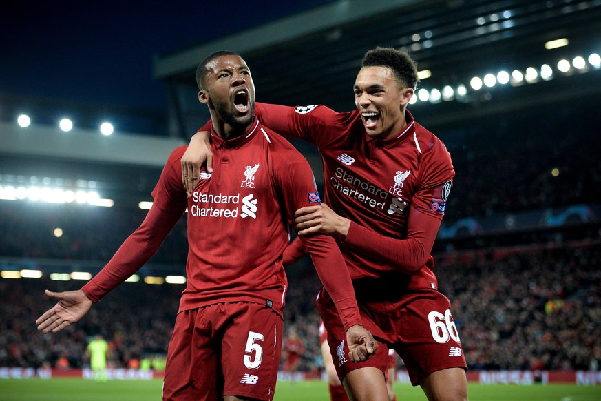 epa07554593 Liverpool's Georginio Wijnaldum (L) celebrates with his teammate Trent Alexander-Arnold (R) after scoring the 3-0 goal during the UEFA Champions League semi final second leg soccer match between Liverpool FC and FC Barcelona at Anfield stadium in Liverpool, Britain, 07 May 2019.  EPA/PETER POWELL
