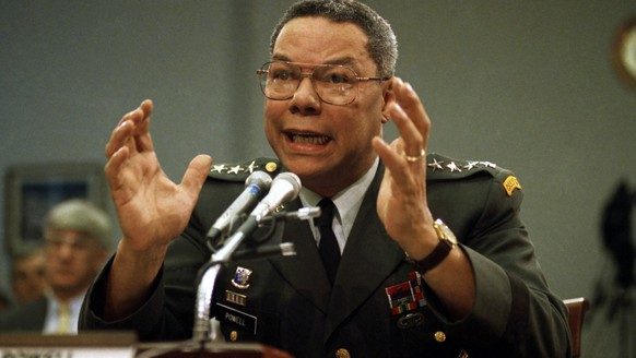 FILE - In this Sept. 25, 1991, file photo, Gen. Colin Powell, chairman of the Joint Chiefs of Staff, gestures on Capitol Hill in Washington, at a House Armed Services subcommittee. Powell was the first black officer to serve as Joint Chiefs chairman, and held the job from Oct. 1, 1989, in the waning days of the Cold War, to Sept. 30, 1993. (AP Photo/Marcy Nighswander, File)