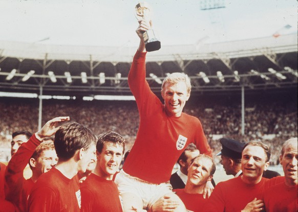 The July 30, 1966 photo shows England's soccer captain Bobby Moore, carried shoulder high by his team mates, holding aloft the World Cup trophy. England defeated Germany 4-2 in the final, played at London's Wembley Stadium. From left to right, goalkeeper Gordon Banks (partially obscured), Alan Ball, Martin Peters, Geoff Hurst, Moore, Ray Wilson, George Cohen and Bobby Charlton. Another Germany vs. England match at the World Cup brings back memories of classic moments that include a disputed goal in the final, the English losing a 2-0 lead, and a dramatic shootout win for the Germanys. The two teams meet in the last 16 on Sunday and could well write another chapter in one of soccer's most famous rivalries. (AP Photo)