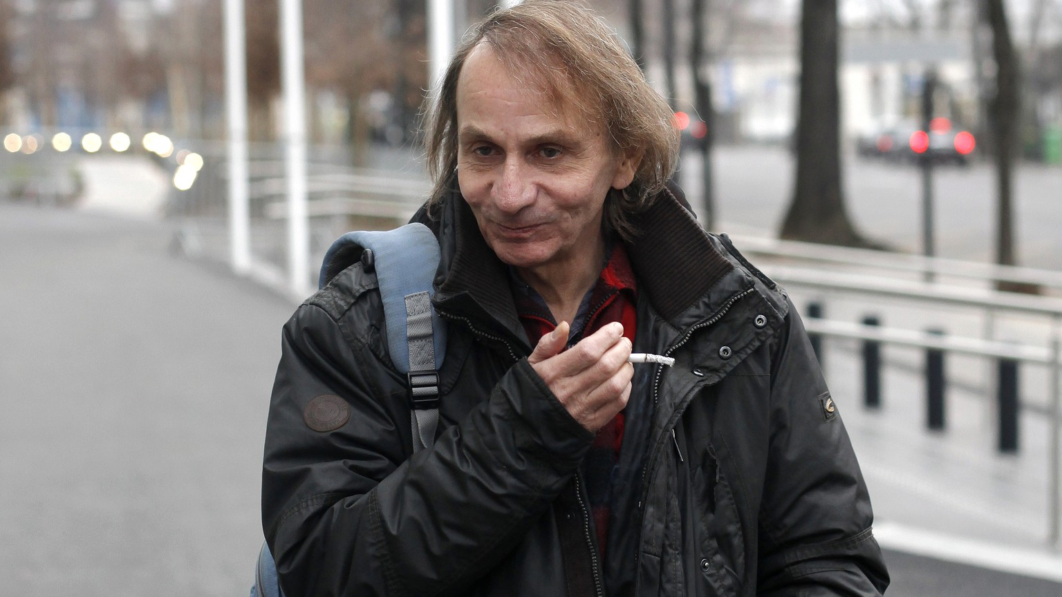 "FOR STORY SLUGGED EU BOOKS HOULLEBECQ SUBMISSION BY GREG KELLER  - This Wednesday, Jan. 7, 2015 photo shows French novelist Michel Houellebecq after an interview on radio station France Inter, in Paris. The latest novel by Michel Houellebecq, the bad boy of French letters, has been called everything from an Islamophobic rant to a ""French literary suicide."" Imagining the election of a Muslim president in France, ""Submission"" struck a raw nerve when it came out this year on the same day as the Charlie Hebdo attacks in Paris. (AP Photo/Thibault Camus)"