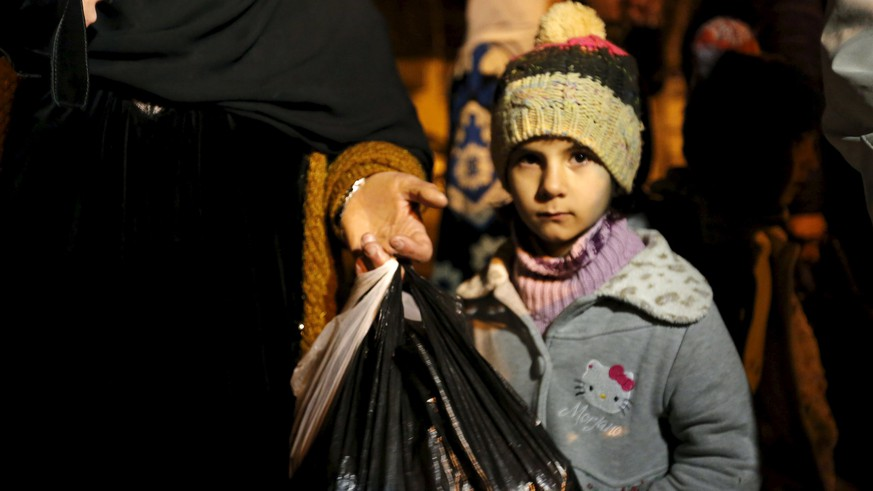 A Syrian girl waits to depart Madaya with her family, whose members say they have received permission from the Syrian government to leave the besieged town, after an aid convoy entered Madaya, Syria January 11, 2016. An aid convoy entered a besieged Syrian town on Monday where thousands have been trapped without supplies for months and people are reported to have died of starvation. Trucks carrying food and medical supplies reached Madaya near the Lebanese border and began to distribute aid as part of an agreement between warring sides, the United Nations and the Red Cross said. REUTERS/Omar Sanadiki