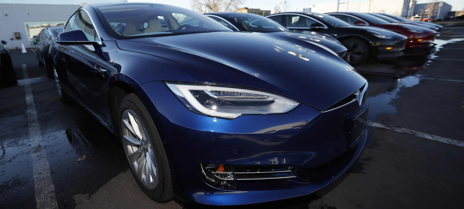 FILE - In this Sunday, Feb. 3, 2019, file photograph, an unsold 2019 S75D sits at a Tesla dealership in Littleton, Colo. Tesla's assembly lines slowed down during a rocky start to the new year, which will likely magnify nagging doubts about whether the electric car pioneer will be able to make the leap into mass market. (AP Photo/David Zalubowski, File)