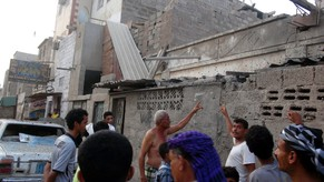 epa04853584 People gather next houses allegedly damaged in the shelling of a neighborhood by the Houthi rebels and their allies in the southern port city of Aden, Yemen, 19 July 2015. According to reports, the Houthi rebels and allied military units bombed a neighborhood in Aden, killing at least 45 civilians and wounding more than 170 others.  EPA/STRINGER