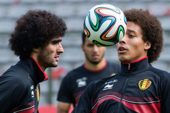 Belgium's national soccer team players Axel Witsel, right, and Marouane Fellaini practice during their last training in Belgium before leaving for Brazil at the King Baudouin stadium in Brussels, Sunday June 8, 2014. Belgium will play against South Korea, Russia and Algeria in Group H of the World Cup 2014 in Brazil. (AP Photo/Geert Vanden Wijngaert)