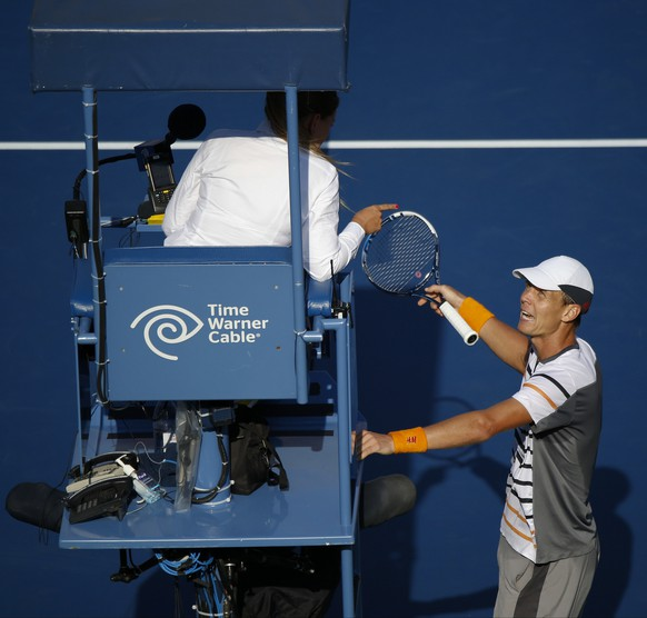 Tomas Berdych, of the Czech Republic, argues with the chair umpire who ruled that a ball hit by Marin Cilic, of Croatia, bounced twice before hitting Berdych's racket during the quarterfinals of the 2014 U.S. Open tennis tournament, Thursday, Sept. 4, 2014, in New York. (AP Photo/Seth Wenig)