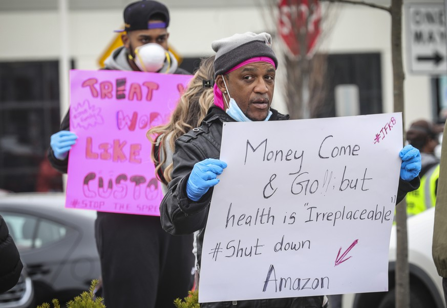 Gerald Bryson, left, join workers at an Amazon fulfillment center in Staten Island, N.Y., protesting conditions in the company's warehouse, Monday March 30, 2020, in New York. Workers say Amazon is not doing enough to to keep workers safe from the spread of COVID-19.