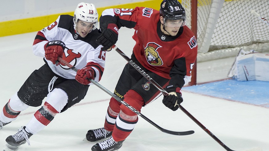 Ottawa Senators' Logan Brown, right, is checked by New Jersey Devils' Nico Hischier, of Switzerland, during the third period of an NHL preseason hockey game in Summerside, Prince Edward Island, Monday, Sept. 25, 2017. (Andrew Vaughan/The Canadian Press via AP)