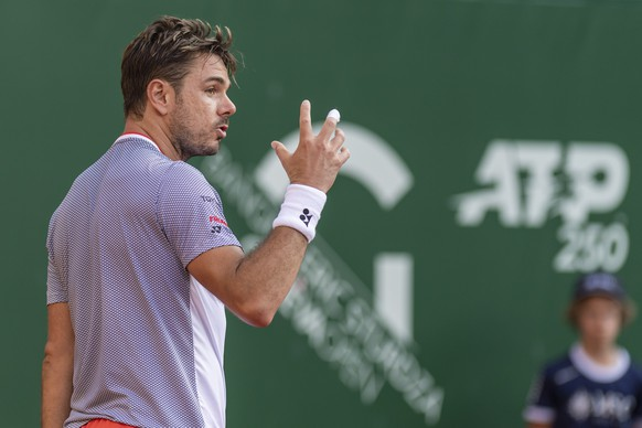"Stanislas ""Stan"" Wawrinka, of Switzerland, reacts after losing a point to Damir Dzumhur, of Bosnia and Herzegovina, during their second round match, at the ATP 250 Geneva Open tournament in Geneva, Switzerland, Wednesday, May 22, 2019. (KEYSTONE/Martial Trezzini)"